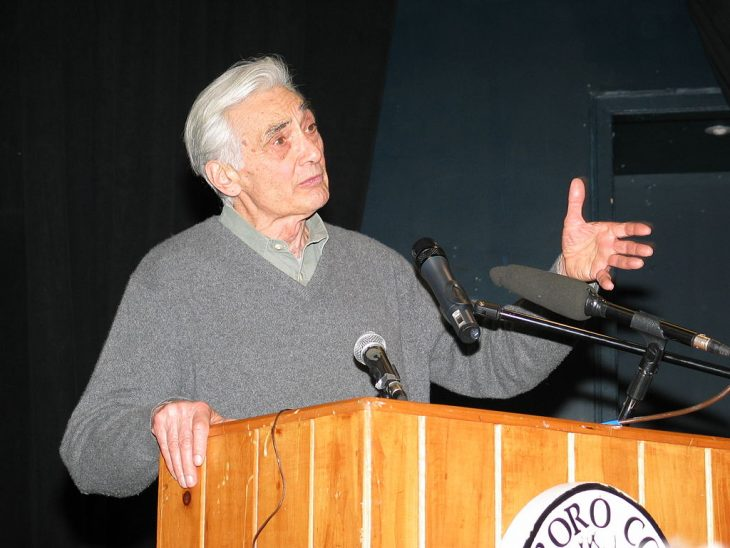 Howard Zinn speaking at a college