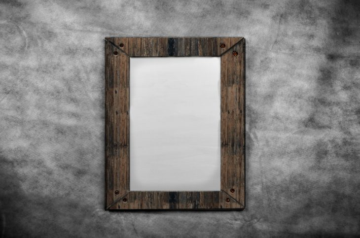 Blank Canvas in Old Wooden Frame