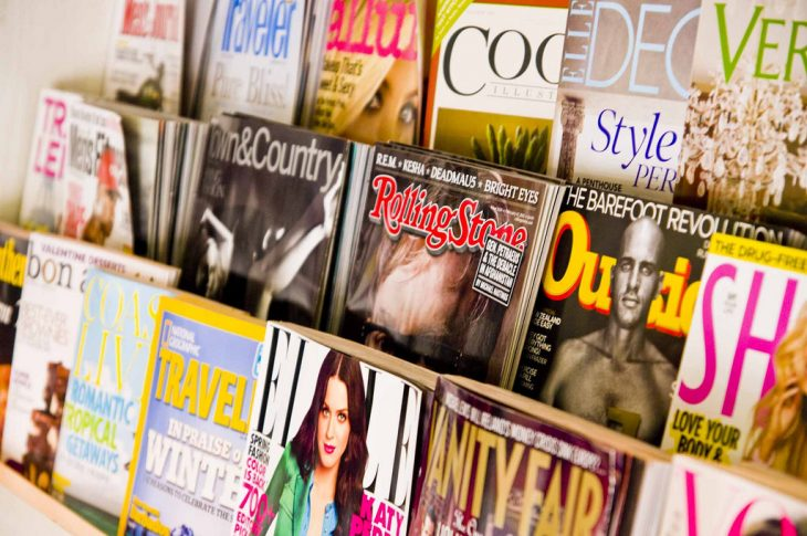 Magazines displayed on a rack Photo Credit by CC 2.0 Ken Hawkins