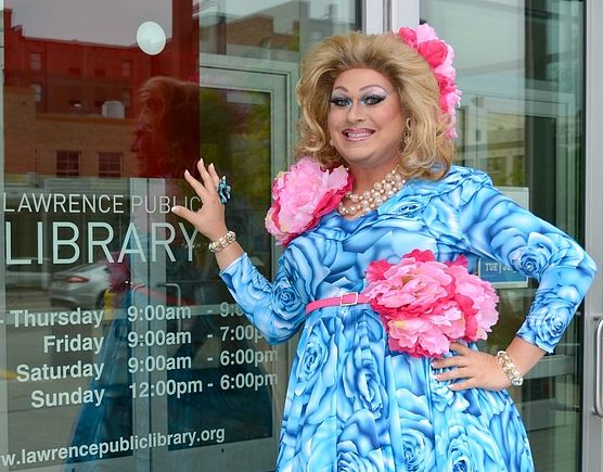 Drag queen Deja Brooks is pictured near the entrance of the Lawrence Public Library. Photo via Lawrence Journal World http://www2.ljworld.com/photos/2017/oct/06/319711/
