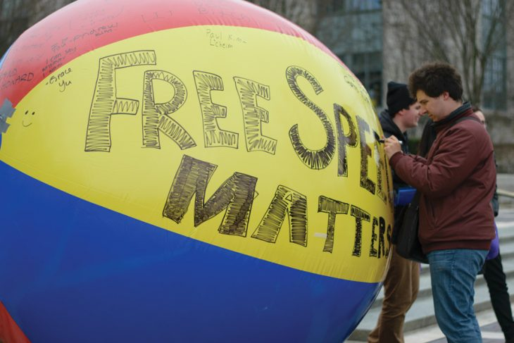 Image credit: Maytham Al-Zayer / The Daily Northwestern under Fair Use. Caption / alt text: Flexing the First Amendment with the 'free speech ball' provided by Young Americans for Liberty at Northwestern University.