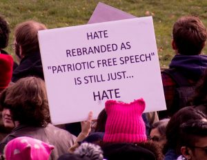 "Poster reading ""Hate rebranded as ""patriotic free speech"" is still just hate"" at an antifascist rally"