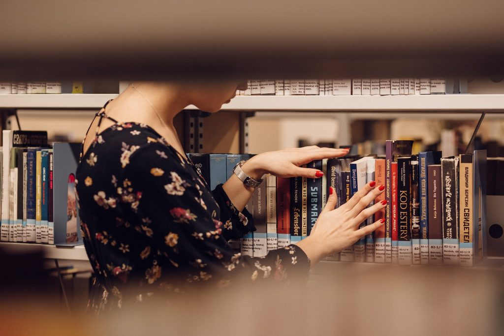 person browsing library shelf