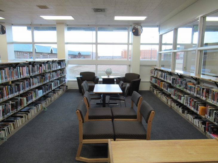 A library in a Colorado state prison. Taken by Erin Boyington. ALT TEXT: An empty library in a Colorado state prison.