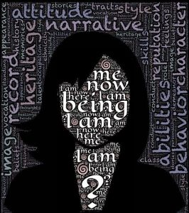 silhouette of woman's face, blank white with words over face: me, now, here, I am here being; words in background: behavior, heritage, narrative, reputation, abilities, image, etc.