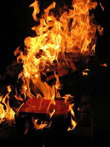 burning book with black background