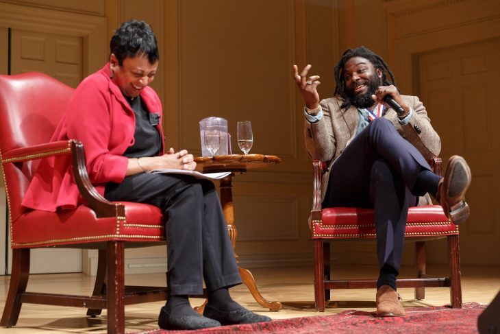 Newly-appointed National Ambassador for Young People's Literature Jason Reynolds and Librarian of Congress Carla Hayden speak to local school groups during Reynolds' induction ceremony at the Library, January 16, 2020. Photo by Shawn Miller/Library of Congress.