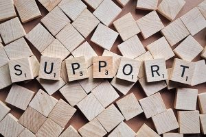"""wooden tiles spell the word """"support"""""""