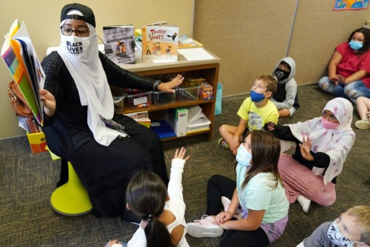 Minnesota's 2020 Teacher of the Year Quorsho Hassan reading to her students.